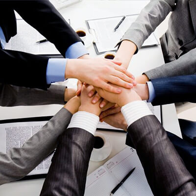 group of business people with their hands in a circle